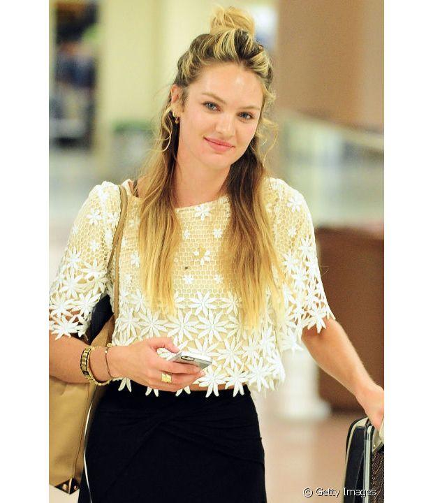A top Candice Swanepoel apostou no penteado com fios despojados
